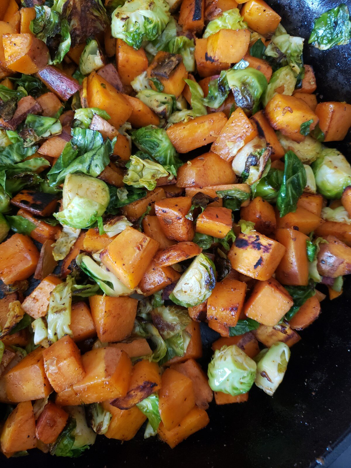 Sweet potatoes and brussel sprouts are the power couple this time of year. When you add that smokey component to them it creates a burst of savory goodness. Your meat eaters won't be missing anything with this hash!