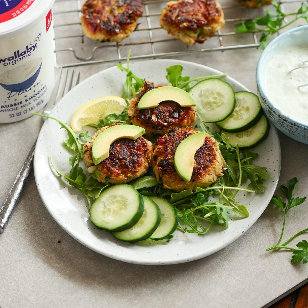 Pan fried crab cakes with  cucumber dill yogurt sauce