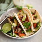 Mushroom and sweet potato tacos with garlic tahini