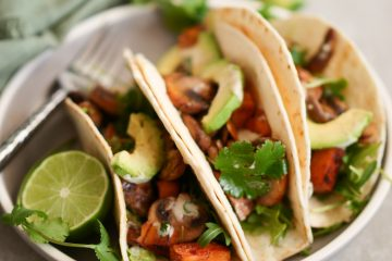 Mushroom and sweet potato tacos with garlic tahini