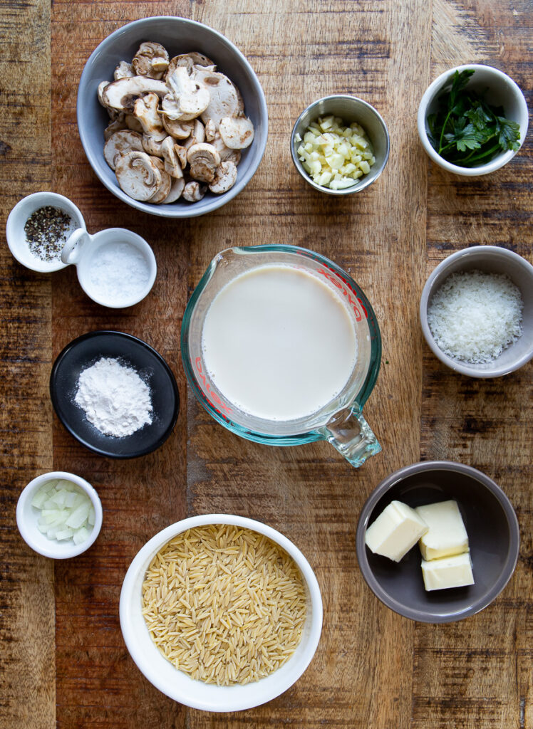 All the ingredients for orzo. Mushrooms, garlic, parsley, cheese, milk, starch, salt & pepper.